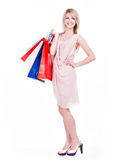 Young blonde woman with colorful shopping bags. Stock Photography