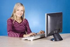 Young blonde woman at the computer Stock Images