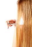 Young blonde woman cutting her hair with scissors. Stock Photos
