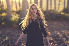 Young blonde woman dancing in poplar forest Stock Photo