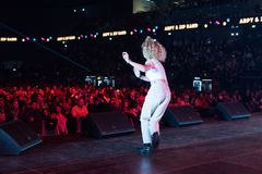 Young blonde woman dancing on the stage royalty free stock photo