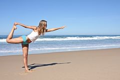 Young blonde woman doing exercises. At the beach along the atlantic ocean in Portugal Stock Images