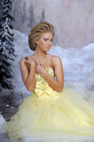 Young blonde woman in an elegant yellow dress Royalty Free Stock Image