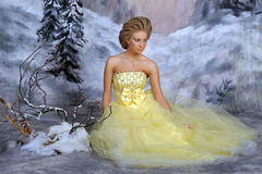 Young blonde woman in an elegant yellow dress Royalty Free Stock Photography