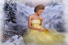 Young blonde woman in an elegant yellow dress Stock Photo