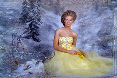 Young blonde woman in an elegant yellow dress Stock Photography