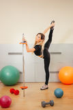 Young blonde woman engaged in fitness gymnastics Stock Image