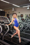 Young blonde woman engaged in fitness gymnastics in the gym Royalty Free Stock Photography