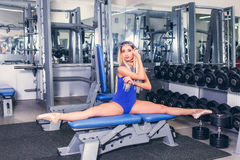 Young blonde woman engaged in fitness gymnastics in the gym Stock Photography