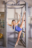 Young blonde woman engaged in fitness gymnastics in the gym Stock Image