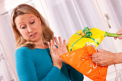 Young blonde woman gets uninspired presents Stock Images