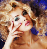 Young blonde woman with glamour makeup and hairstyle waves close up Royalty Free Stock Photography