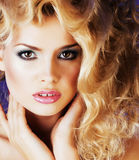 Young blonde woman with glamour makeup and hairstyle waves close Royalty Free Stock Photography