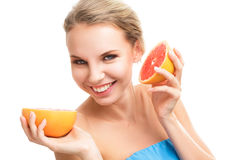 Young blonde woman with grapefruit Stock Image