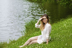 Young blonde woman on green meadow Royalty Free Stock Image