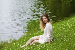 Young blonde woman on green meadow Royalty Free Stock Photo
