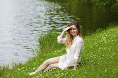 Young blonde woman on green meadow Royalty Free Stock Photos