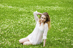 Young blonde woman on green meadow Stock Images