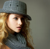 Young Blonde Woman with Hat and Scarf Stock Image