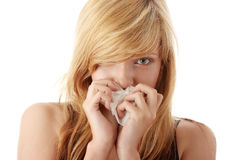 Young blonde woman having a cold Stock Photos