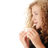 Young blonde woman having a cold Stock Photo