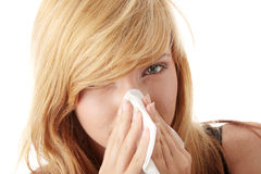 Young blonde woman having a cold Stock Image