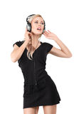 Young blonde woman with headphones Stock Images