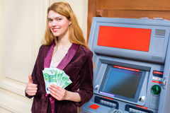 Young blonde woman is holding a cash dollars Stock Images