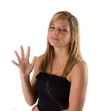 Young blonde woman holding five fingers. Portrait of a beautiful young blonde woman in a black dress holding up five fingers isolated on a white background stock photography
