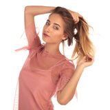 Blonde woman holding her hair up in a pony tail Royalty Free Stock Photography