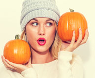 Young woman holding pumpkins Royalty Free Stock Image