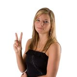 Young blonde woman holding two fingers Stock Images