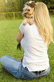 Young blonde woman hugging her cute Yorkshire terrier Stock Photography
