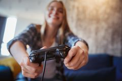 Young woman at home in the living room playing controller close-up stock images