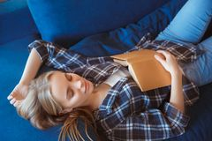 Young woman at home in the living room sleeping on coach royalty free stock photo