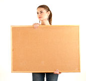 Young blonde woman keeping cork board Royalty Free Stock Images
