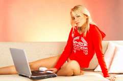 Young Blonde woman with laptop computer. Stock Photography