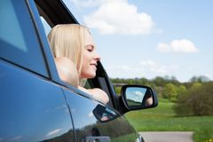 Young Blonde Woman Leaning On Car Window Royalty Free Stock Photos