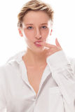 Young blonde woman licking her finger. Young blonde woman sucking her finger on white background Royalty Free Stock Photo