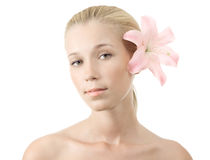 Young blonde woman with lily isolated Royalty Free Stock Photography