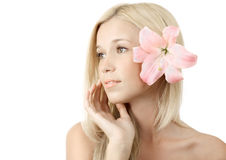 Young blonde woman with lily isolated Stock Photo