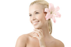 Young blonde woman with lily smile isolated Stock Photography