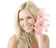 Young blonde woman with lily smile isolated Royalty Free Stock Photo