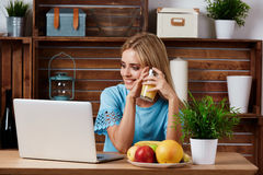 Young blonde woman looking for a recipe Royalty Free Stock Photos