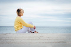Young blonde woman looking through the sea Royalty Free Stock Image