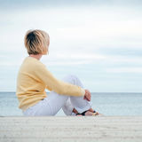 Young blonde woman looking through the sea Royalty Free Stock Photography