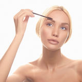 Young blonde woman make-up Stock Images