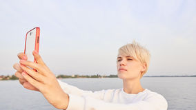 Young blonde woman makes selfy Stock Image
