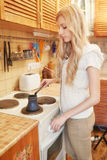 Young blonde woman making coffee Stock Image
