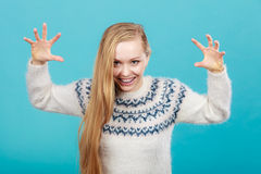 Young blonde woman making scary faces Stock Photos